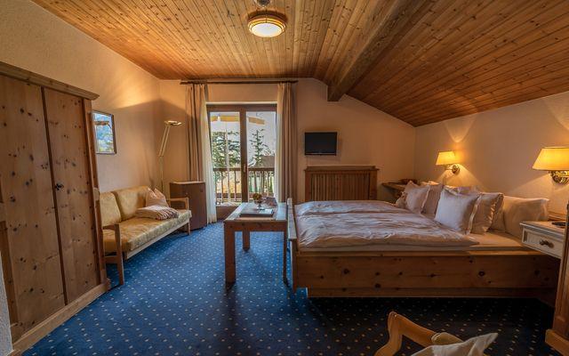 camera doppia standard in stile rusticoa partire da 24 m²